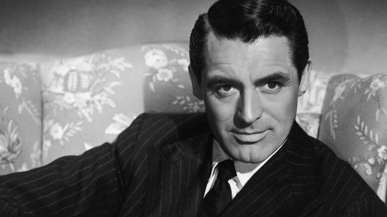 "Cary Grant - Cary Grant was an English actor who became an American citizen in 1942. Known for his transatlantic accent, debonair demeanor, and ""dashing good looks"", Grant is considered one of Hollywood's definitive leading men."